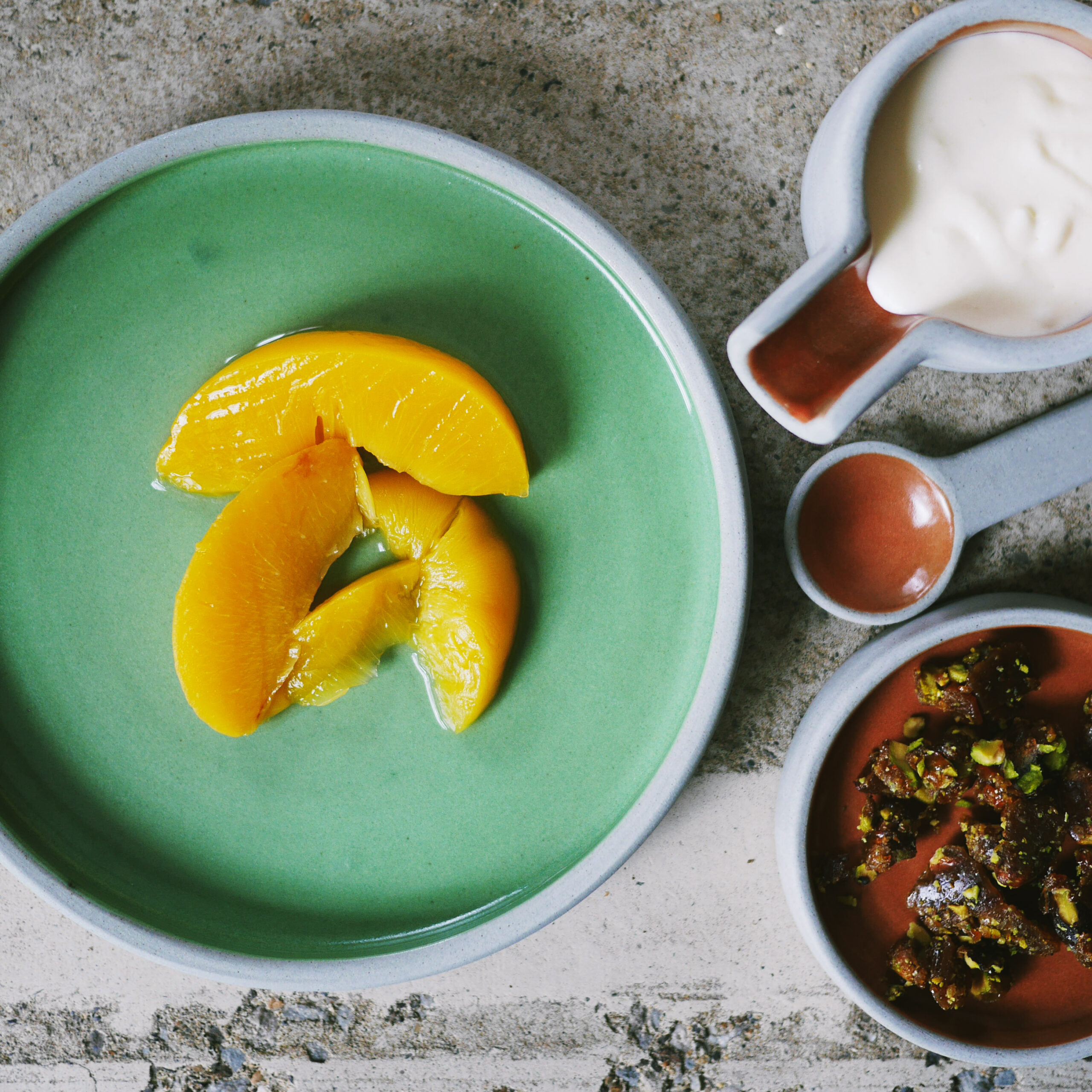 A simple peach syrup dessert with pistachios